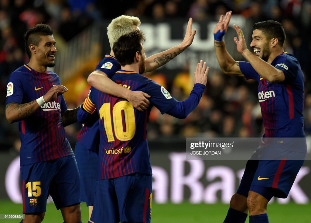 Barcelona's Croatian midfielder Ivan Rakitic (2L) celebrates a goal with Barcelona's Brazilian midfielder Paulinho (L), Barcelona's Argentinian forward Lionel Messi (3L) and Barcelona's Uruguayan forward Luis Suarez during the Spanish 'Copa del Rey' (King's cup) second leg semi-final football match between Valencia CF and FC Barcelona at the Mestalla stadium in Valencia on February 8, 2018. /