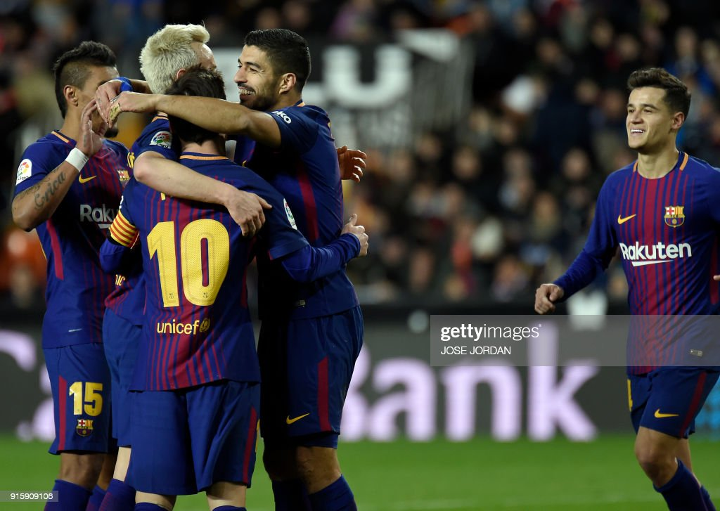 Barcelona's Croatian midfielder Ivan Rakitic (2L) celebrates a goal with teammates during the Spanish 'Copa del Rey' (King's cup) second leg semi-final football match between Valencia CF and FC Barcelona at the Mestalla stadium in Valencia on February 8, 2018. /