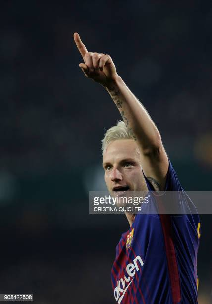 Barcelona's Croatian midfielder Ivan Rakitic celebrates after scoring a goal during the Spanish league football match between Real Betis and FC...