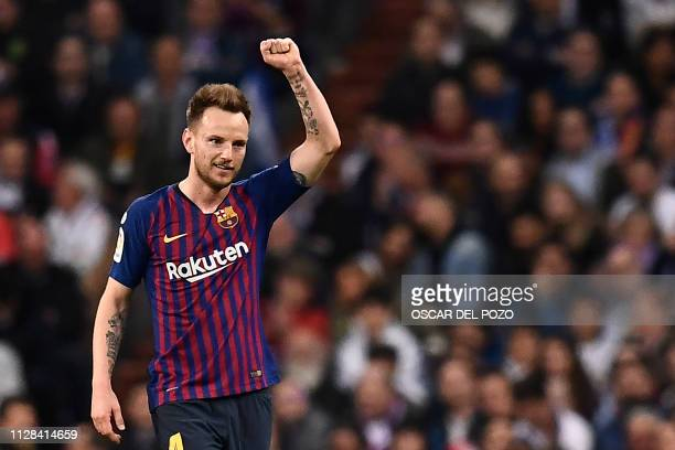 Barcelona's Croatian midfielder Ivan Rakitic celebrates his goal during the Spanish league football match between Real Madrid CF and FC Barcelona at...