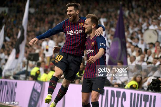 Barcelona's Croatian midfielder Ivan Rakitic celebrates his goal with Barcelona's Argentinian forward Lionel Messi during the Spanish league football...
