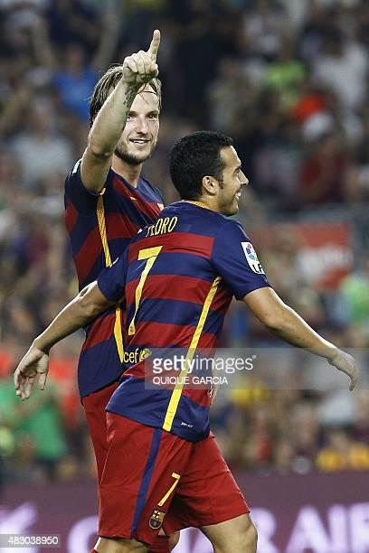 Barcelona's Croatian midfielder Ivan Rakitic celebrates his goal with Barcelona's forward Pedro Rodriguez during the 50th Joan Gamper Trophy football...