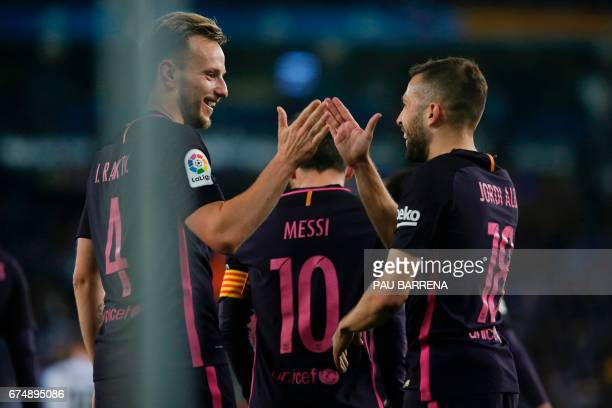 Barcelona's Croatian midfielder Ivan Rakitic celebrates with Barcelona's defender Jordi Alba after scoring during the Spanish league football match...