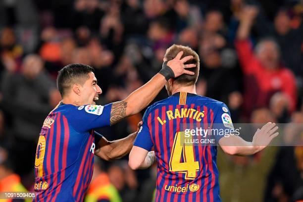Barcelona's Croatian midfielder Ivan Rakitic celebrates with Barcelona's Uruguayan forward Luis Suarez after scoring during the Spanish Copa del Rey...