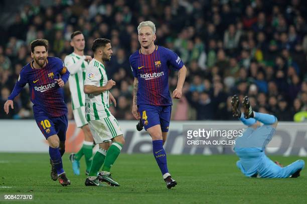 Barcelona's Croatian midfielder Ivan Rakitic celebrates with Barcelona's Argentinian forward Lionel Messi after scoring a goal during the Spanish...