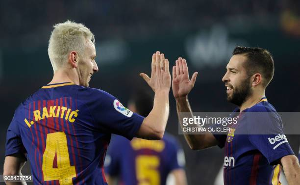 Barcelona's Croatian midfielder Ivan Rakitic celebrates with Barcelona's Spanish defender Jordi Alba after scoring a goal during the Spanish league...