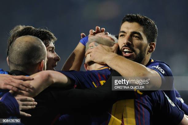 Barcelona's Croatian midfielder Ivan Rakitic celebrates with teammates after scoring a goal during the Spanish league football match between Real...
