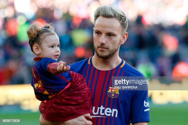 Barcelona's Croatian midfielder Ivan Rakitic poses with his daughter Adara before the Spanish League football match between FC Barcelona and Athletic...