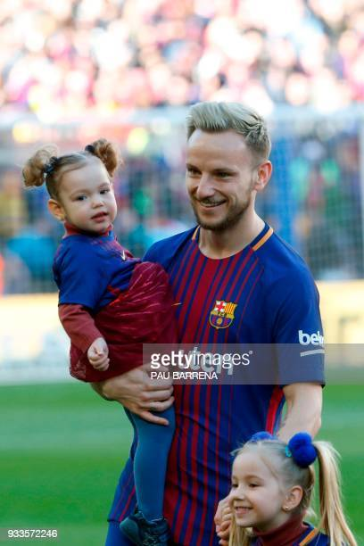 Barcelona's Croatian midfielder Ivan Rakitic poses with his daughters Adara and Althea before the Spanish League football match between FC Barcelona...