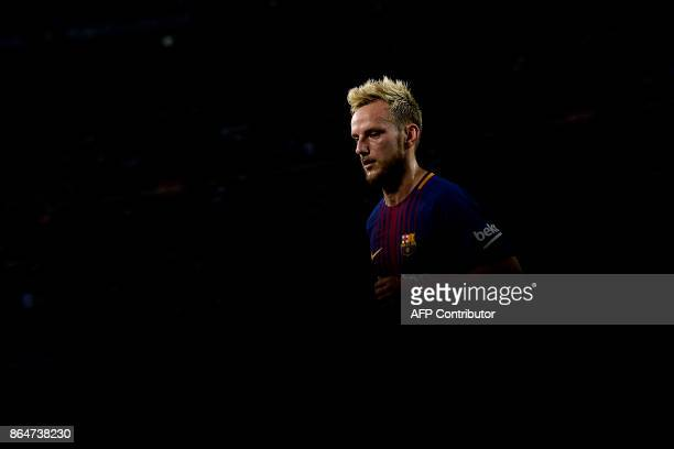 Barcelona's Croatian midfielder Ivan Rakitic runs during the Spanish league football match FC Barcelona vs Malaga CF at the Camp Nou stadium in...