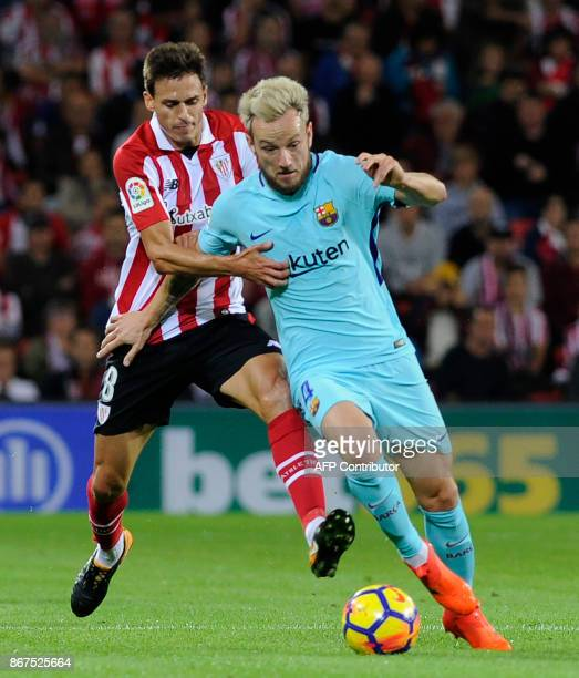 Barcelona's Croatian midfielder Ivan Rakitic vies with Athletic Bilbao's Spanish midfielder Ander Iturraspe during the Spanish league football match...