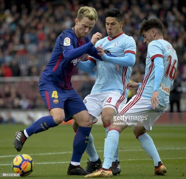 Barcelona's Croatian midfielder Ivan Rakitic vies with Celta's Italian midfielder Facundo Roncaglia and Celta's midfielder Jozabed Sanchez during the...
