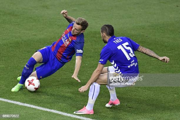 Barcelona's Croatian midfielder Ivan Rakitic vies with Deportivo Alaves' French defender Theo Hernandez during the Spanish Copa del Rey final...