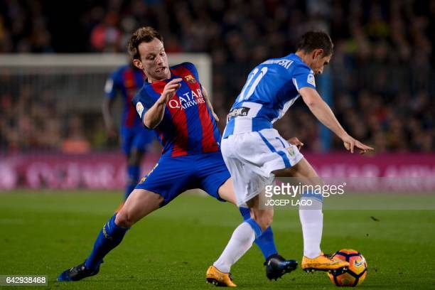 Barcelona's Croatian midfielder Ivan Rakitic vies with Leganes' Argentinian midfielder Alexander Szymanowski during the Spanish league football match...
