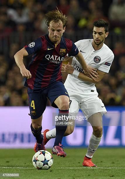 Barcelona's Croatian midfielder Ivan Rakitic vies with Paris Saint-Germain's Argentinian midfielder Javier pastore during the UEFA Champions League...