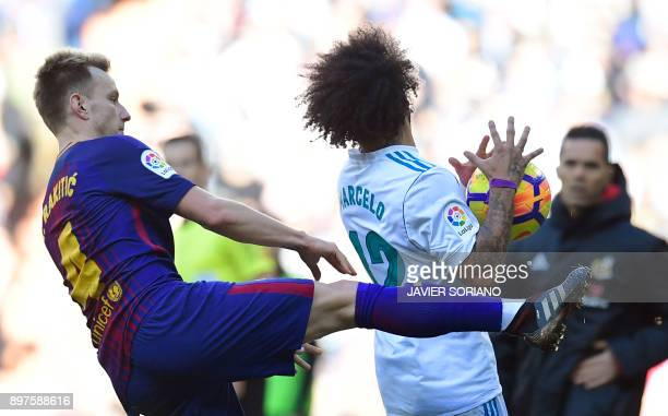 Barcelona's Croatian midfielder Ivan Rakitic vies with Real Madrid's Brazilian defender Marcelo during the Spanish League 'Clasico' football match...