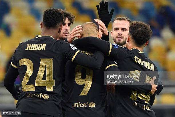 Barcelona's Danish forward Martin Braithwaite celebrates with teammates after scoring a goal during the UEFA Champions League group G football match...