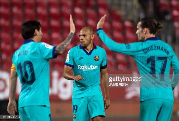 Barcelona´s Danish forward Martin Braithwaite celebrates with Barcelona's Argentine forward Lionel Messi and Barcelona's French forward Antoine...