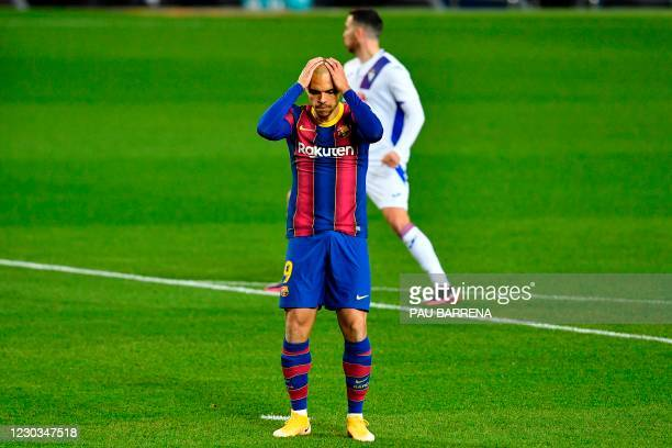 Barcelona's Danish forward Martin Braithwaite reacts after missing a penalty during the Spanish League football match between Barcelona and Eibar at...