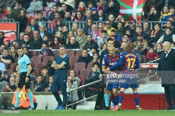 Barcelona´s Danish forward Martin Braithwaite replaces Barcelona's French forward Antoine Griezmann during the Spanish league football match FC...