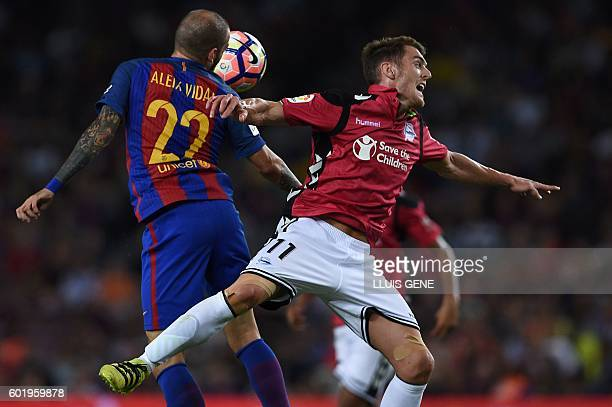 Barcelona's defender Aleix Vidal vies with Alaves' forward Ibai Gomez during the Spanish league football match FC Barcelona vs Deportivo Alaves at...