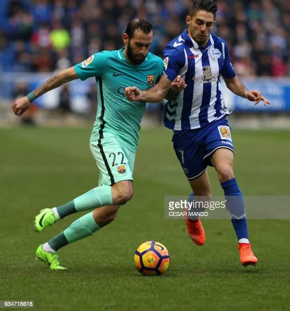 Barcelona's defender Aleix Vidal vies with Deportivo Alaves forward Ruben Sobrino during the Spanish league football match Deportivo Alaves vs FC...