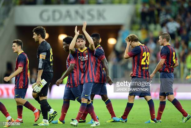 Barcelona's defender Carles Planas applauds to aknowledge the audience while leaving the pitch with teammates after their preseason friendly football...