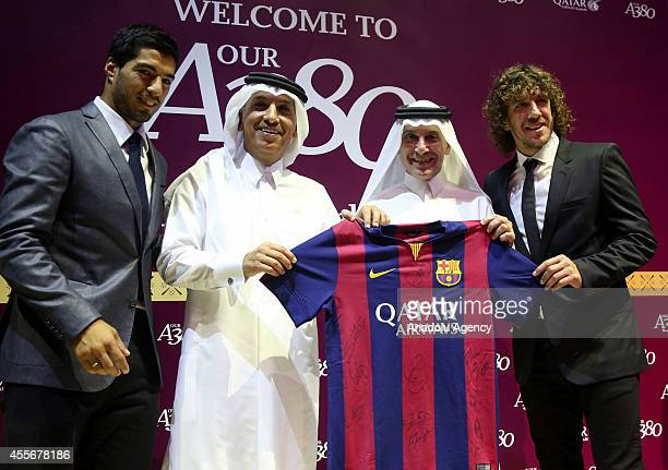 Barcelona's defender Carles Puyol and Akbar Al Baker CEO of Qatar Airways and Luis Suarez of Barcelona pose for the media after the inauguration...