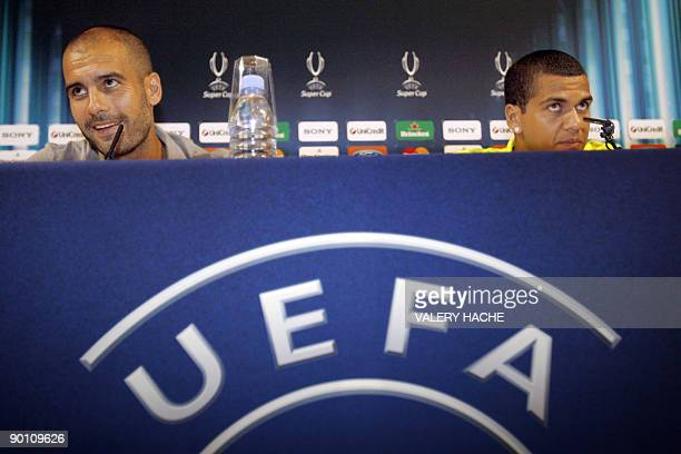 Barcelona's defender Dani Alves and coach Josep Guardiola speak during a press conference on the eve of their UEFA super cup football match FC...