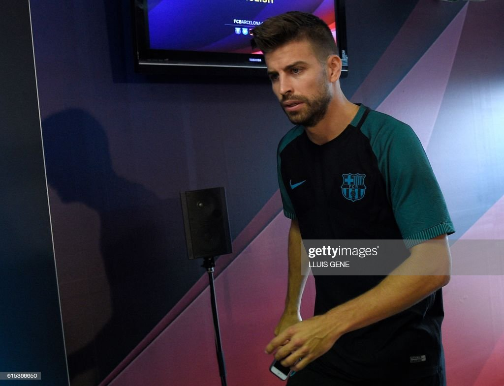 Barcelona's defender Gerard Pique arrives for a press conference at the Sports Center FC Barcelona Joan Gamper in Sant Joan Despi, near Barcelona on October 18, 2016, on the eve of the UEFA Champions League football match FC Barcelona vs Manchester City. / AFP / LLUIS