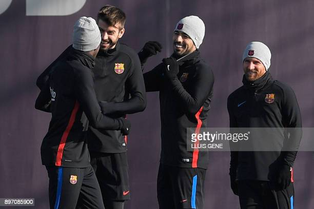 Barcelona's defender Gerard Pique Barcelona's Uruguayan forward Luis Suarez and Barcelona's Argentinian forward Lionel Messi joke with Barcelona's...