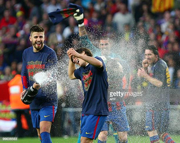 Barcelona's defender Gerard Pique celebrates after winning the Spanish League football match against Valladolid at Camp Nou stadium in Barcelona on...