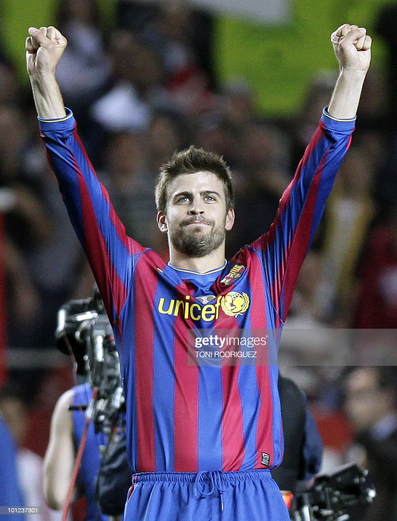 Barcelona's defender Gerard Pique celebrates at the end of their Spanish league football match against Sevilla at Ramon Sanchez Pizjuan stadium in Sevilla on May 8, 2010. Barcelona won 3-2.