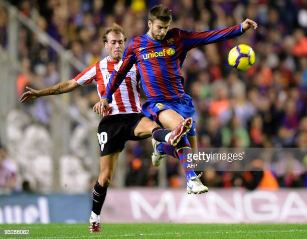 Barcelona's defender Gerard Pique vies for the ball with Athletic Bilbao's midfielder Francisco Javier Yeste during a Spanish league football match...