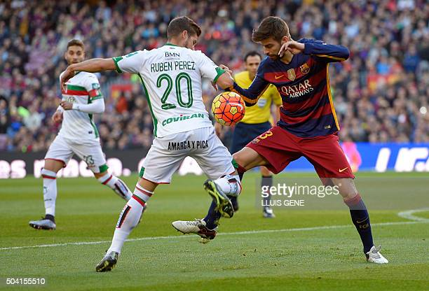 Barcelona's defender Gerard Pique vies with Granada's midfielder Ruben Perez during the Spanish league football match FC Barcelona vs Granada CF at...