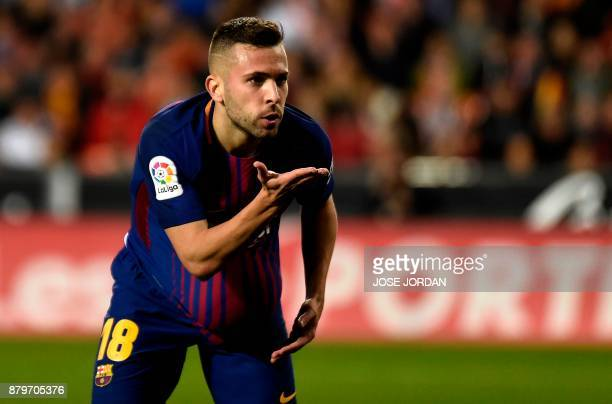 Barcelona's defender Jordi Alba celebrates after scoring during the Spanish league football match Valencia CF and FC Barcelona at Mestalla stadium in...