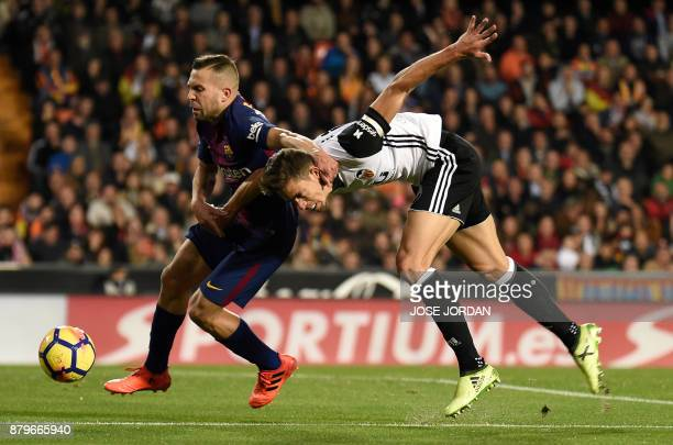Barcelona's defender Jordi Alba vies with Valencia's Brazilian defender Gabriel during the Spanish league football match Valencia CF against FC...