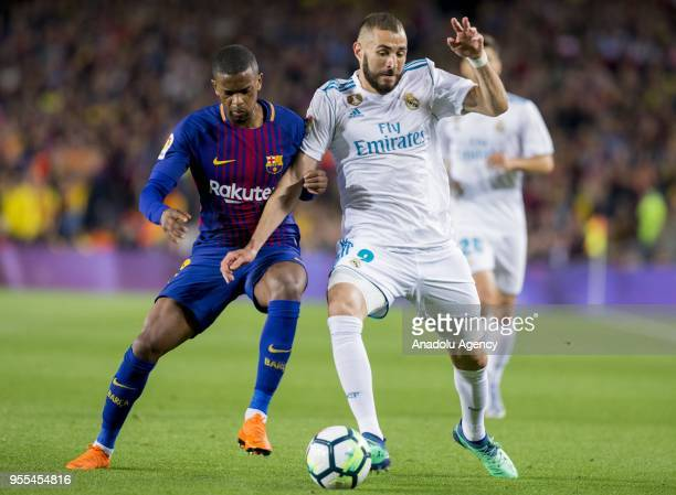 Barcelona's defender Nelson Semedo vies with Real Madrid forward Benzema during the Spanish league football match between FC Barcelona and Real...