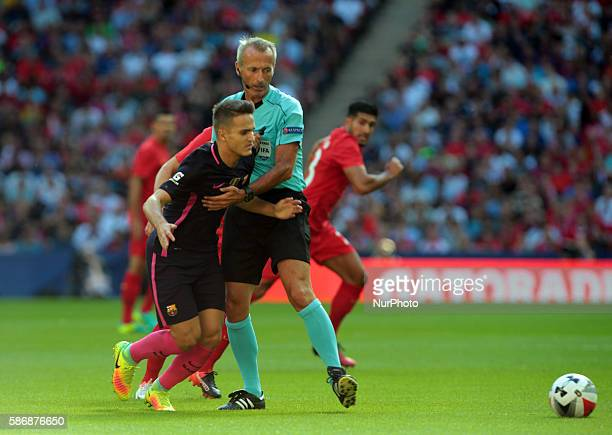 FC Barcelona's Denis Suarez fells against Referee Martin Atkinson during International Championships Cup match between Liverpool FC and FC Barcelona...