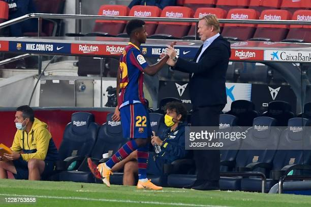Barcelona's Dutch coach Ronald Koeman greets Barcelona's Spanish forward Ansu Fati during the Spanish league football match FC Barcelona against...