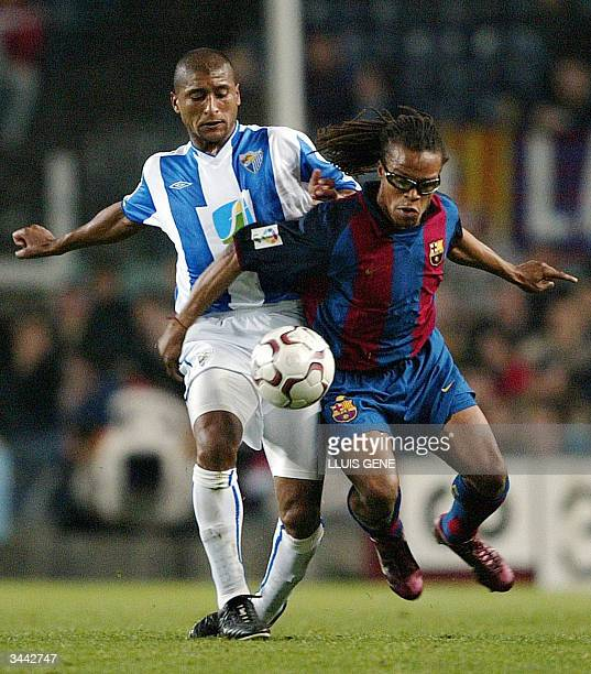 Barcelona's Dutch Edgar Davids vies with CF Malaga's Romero of Uruguay during their Spanish League football match at Camp Nou Stadium in Barcelona 18...