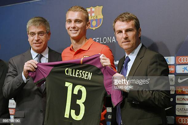FC Barcelona's Dutch goalkeeper Jasper Cillessen poses with his new jersey flanked by Barcelona's third VicePresident Jordi Mestre and Barcelon's...