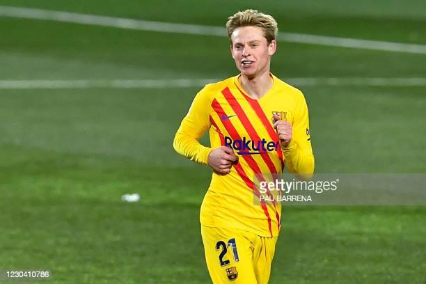 Barcelona's Dutch midfielder Frenkie De Jong celebrates after scoring a goal during the Spanish League football match between Huesca and Barcelona at...