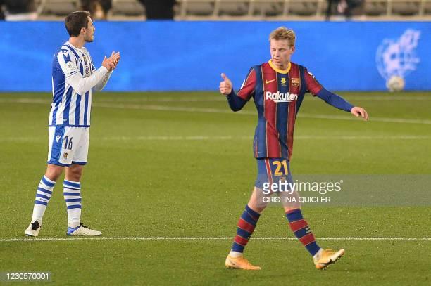 Barcelona's Dutch midfielder Frenkie De Jong celebrates after scoring the opening goal during the Spanish Super Cup semi final football match between...
