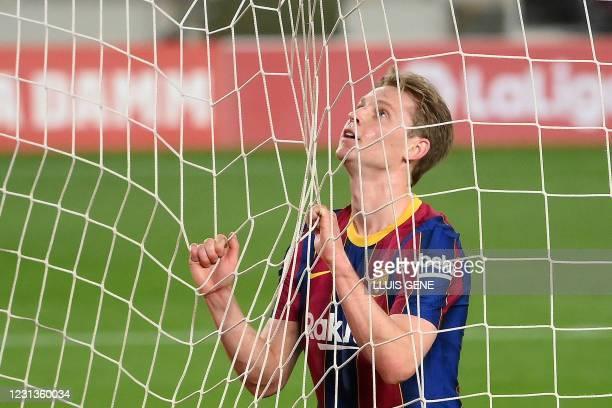 Barcelona's Dutch midfielder Frenkie De Jong reacts after missing a goal opportunity during the Spanish league football match between FC Barcelona...