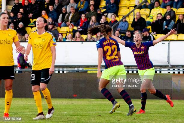 Barcelona's Dutch midfielder Lieke Martens celebrates scoring the opening goal with her teammates during the UEFA women's Champions League...