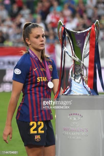 Barcelona's dutch midfielder Lieke Martens walks past the trophy after the UEFA Women's Champions League final football match Lyon v Barcelona in...