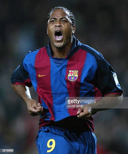Barcelona's Dutch Patrick Kluivert celebrates his first goal against Athletic de Bilbao in a Liga match at Camp Nou Stadium in Barcelona 17 January...