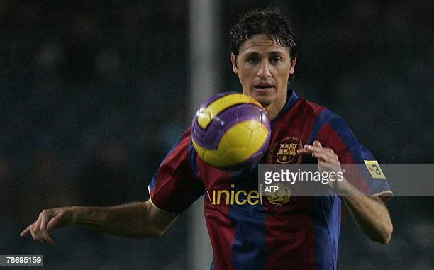 Barcelona's Edmilson holds the ball during their King's Cup second leg football match Barcelona vs Alcoiano at the New Camp in Barcelona 02 January...