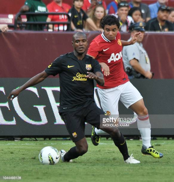 Barcelona's Eric Abidal vies with Manhester United's Rafael during a friendly match at FedEx Field in Landover Maryland on July 30 2011 Manchester...